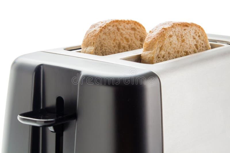 Toaster mit Brotscheiben stockbild