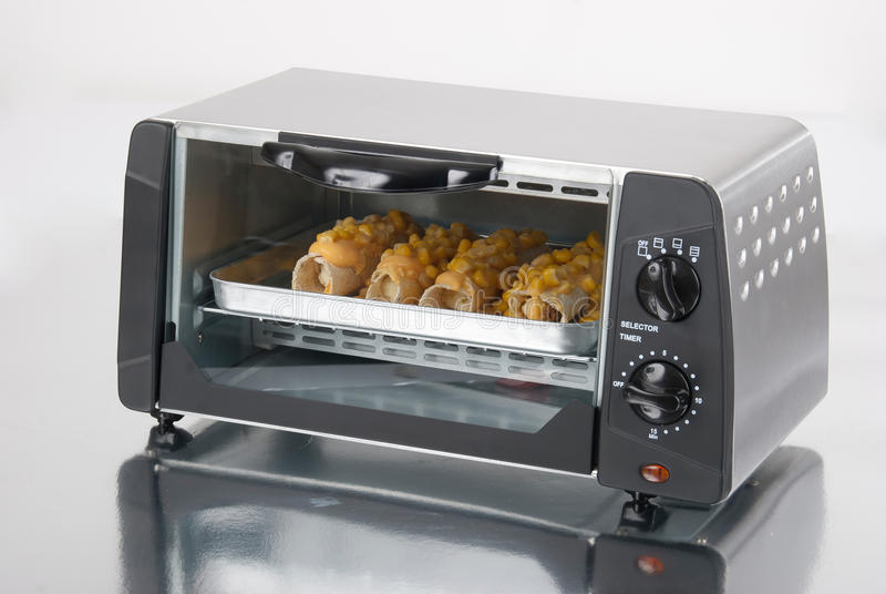 Toaster oven. On a silver background with reflection royalty free stock image