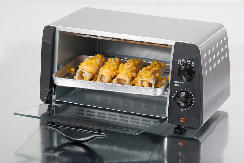 Toaster oven. On a silver background with reflection royalty free stock photography