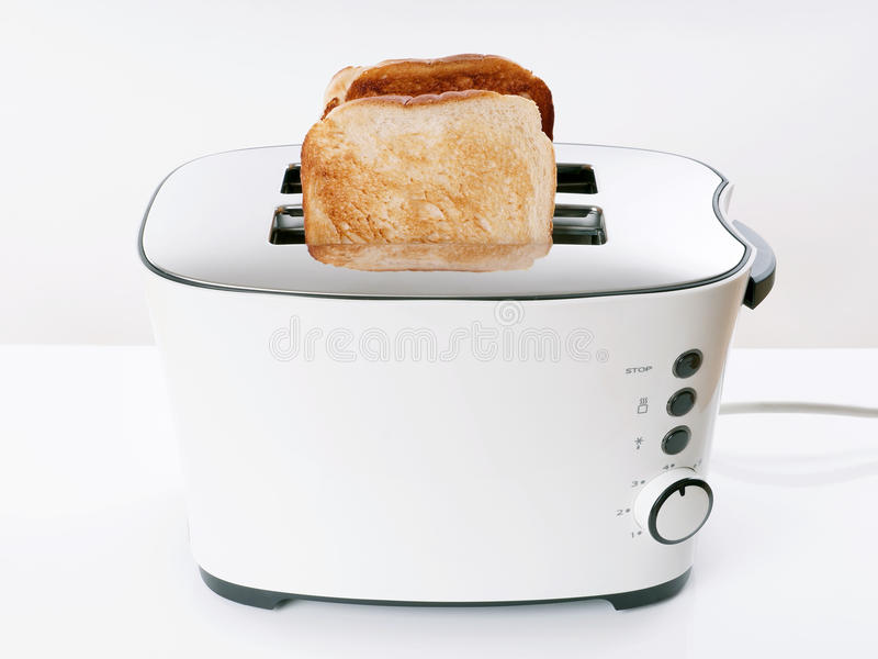 Toaster. Toasting sliced bread in toaster royalty free stock photography