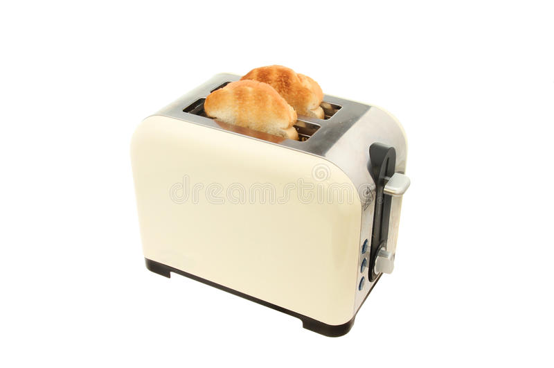 Toaster. With two slices of toast isolated against white royalty free stock photos