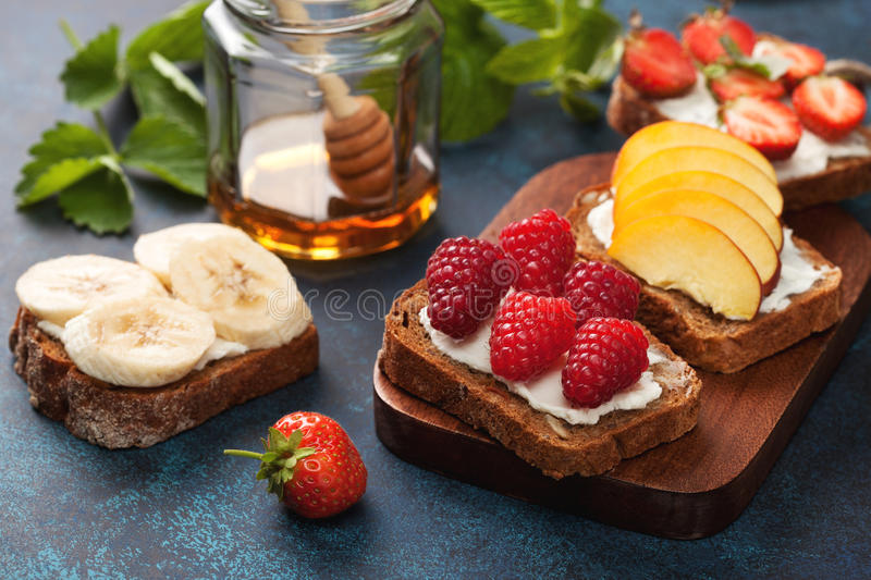 Toasts with cream cheese and fresh berries stock image