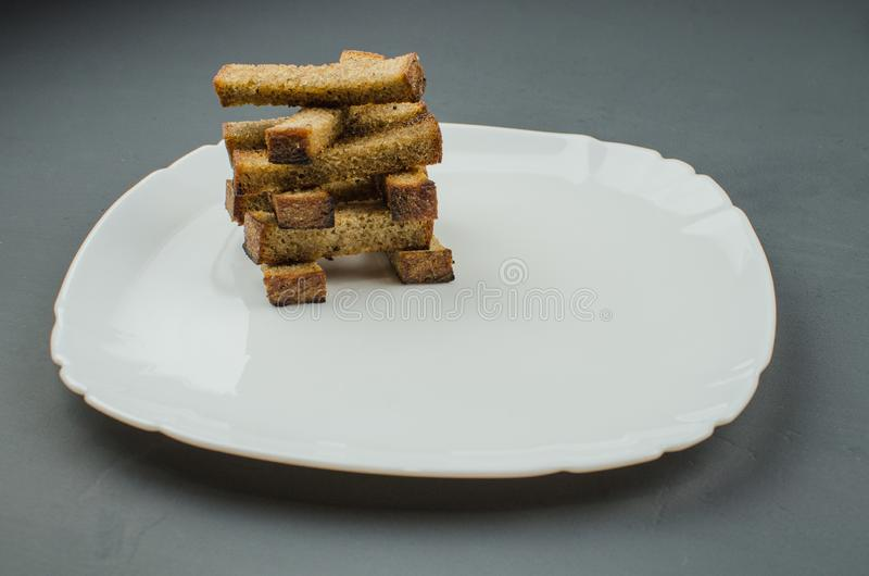 Toasts are fried on a frying pan with spices. Served on a white plate with garlic sauce and barbecue sauce. Toasts are fried on a frying pan with spices. Served royalty free stock image