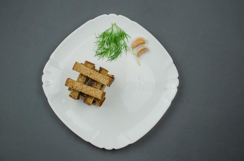 Toasts are fried on a frying pan with spices. Served on a white plate with garlic sauce and barbecue sauce. Toasts are fried on a frying pan with spices. Served royalty free stock photos