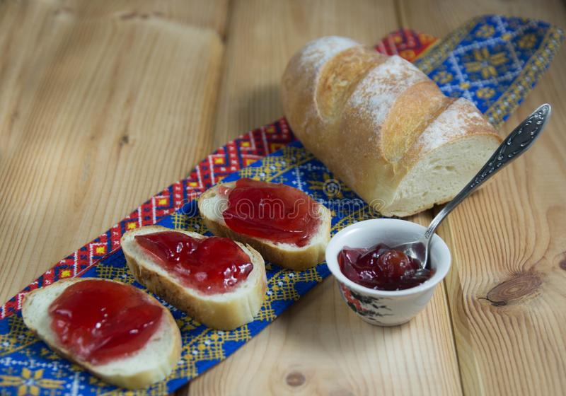 Toasts with jam on wooden background royalty free stock photography