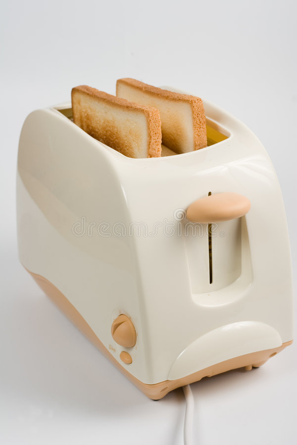 Toasts in toaster stock photos