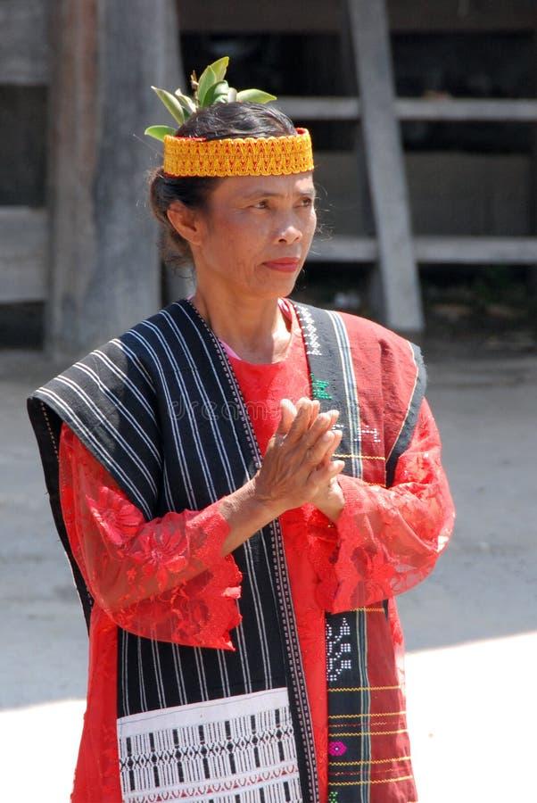 Toba Batak woman. Woman in a traditional dress of Toba Batak tribe in Samosir island, North Sumatra, Indonesia