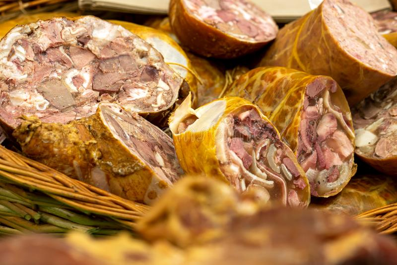 Toba de porc - Sliced pork meat products, traditional romanian food. At winter Christmas market royalty free stock photo