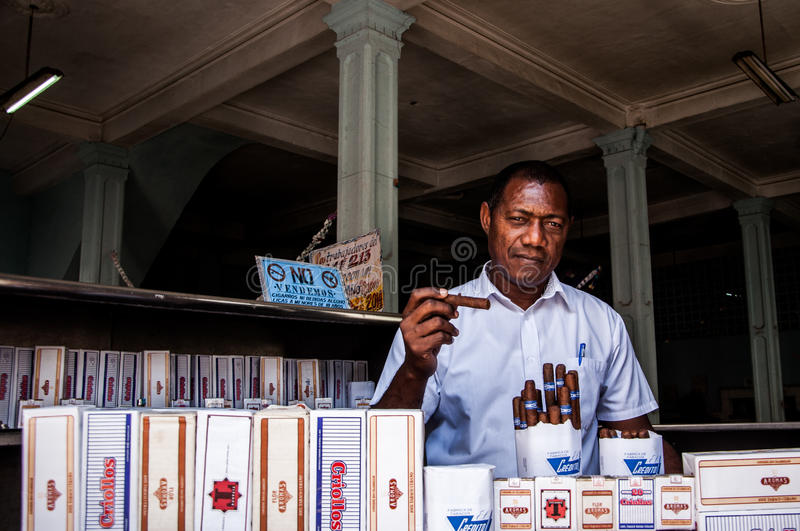 A tobacco and cigar shop owner in Old Havana royalty free stock images