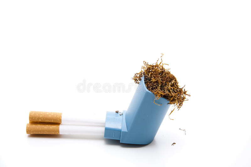 Tobacco with cigarets and Inhaler. Darning tobacco with cigarets and Inhaler on wei0en background royalty free stock photos