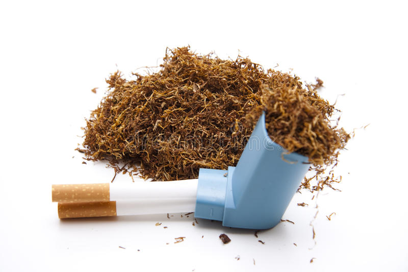 Tobacco with cigarets and Inhaler. Darning tobacco with cigarets and Inhaler on wei0en background stock photo