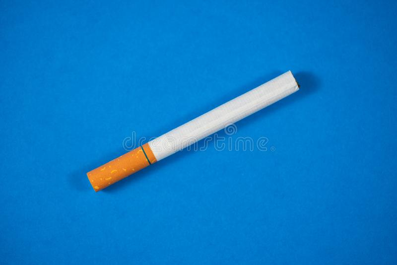 Tobacco Cigarette close up with blue background royalty free stock image