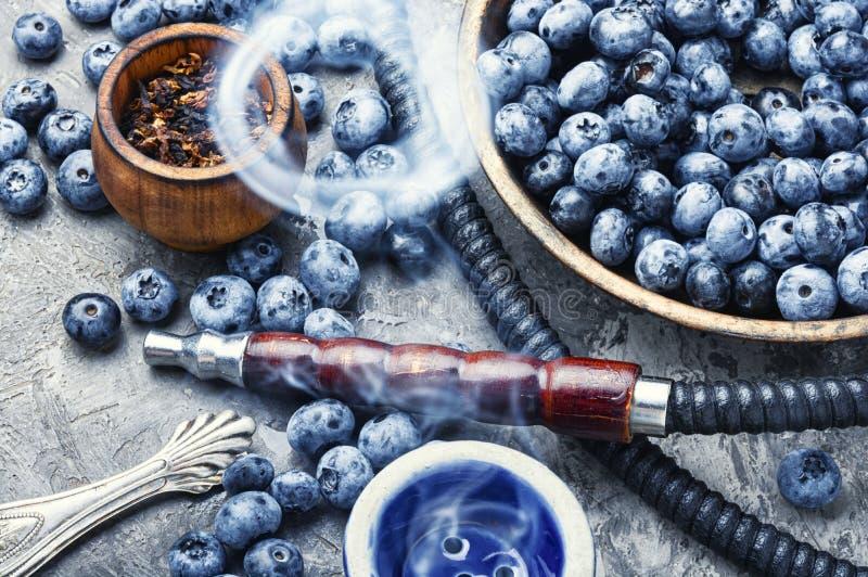 Tobacco hookah with bilberry. Asia kalian.Hookah with bilberry flavor.Smoking berry tobacco.Shisha stock photo