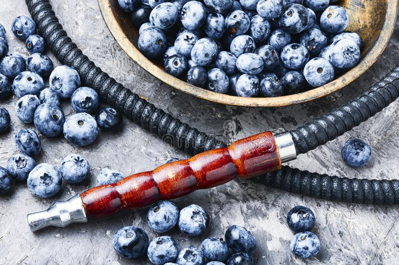 Tobacco hookah with bilberry. Tobacco hookah.Shisha mouthpiece and parts for the smoking hookah.Kalian with blueberries.Berry hookah taste stock images