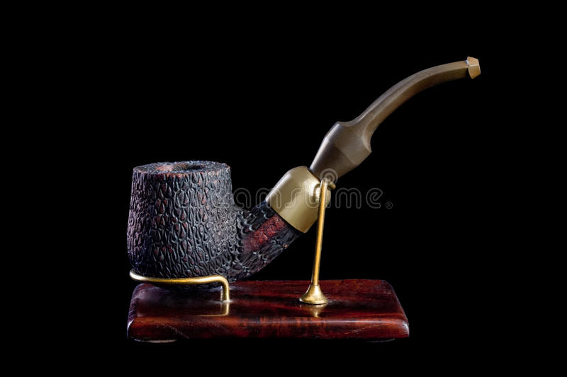 Tobacco pipe. Isolated on Black background stock photo