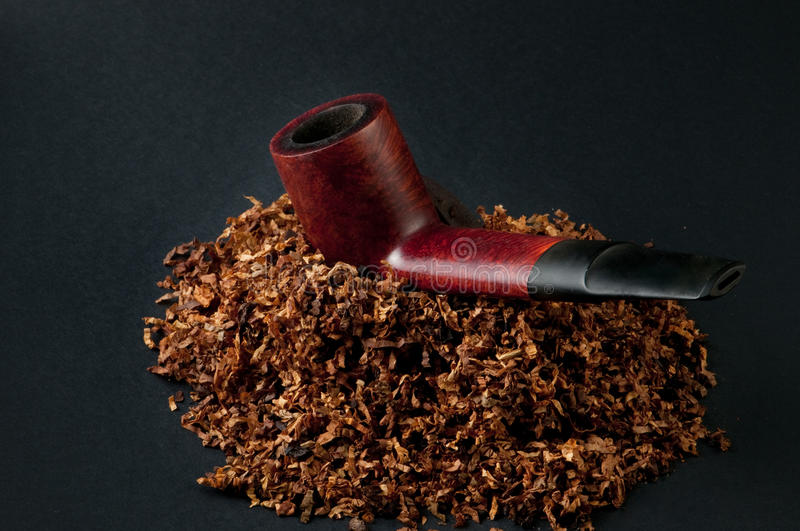 Tobacco and pipe royalty free stock photography