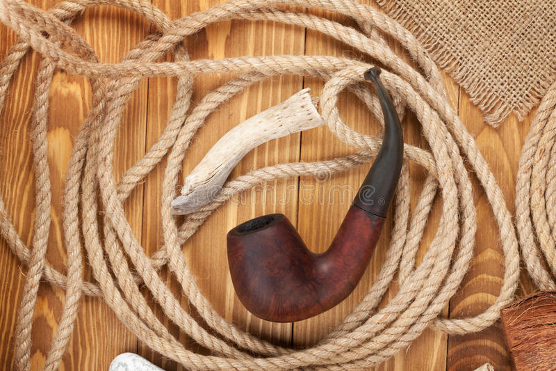 Tobacco pipe and rope stock images