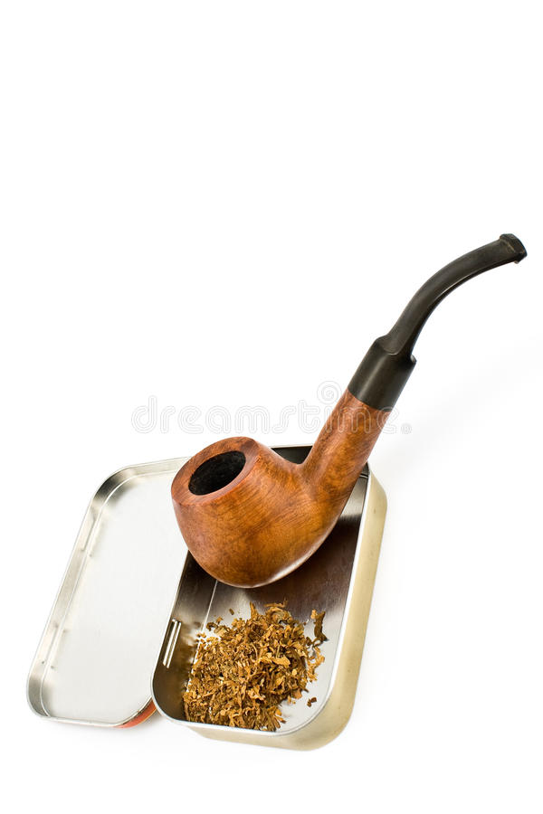 Tobacco pipe with tin box royalty free stock photo