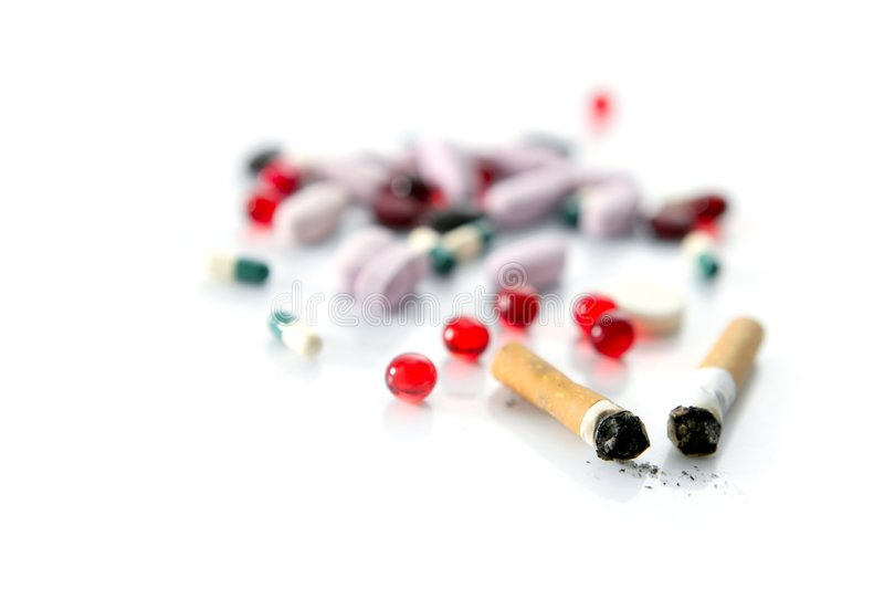 Tobacco, unhealthy dangerous drug and pills royalty free stock photo