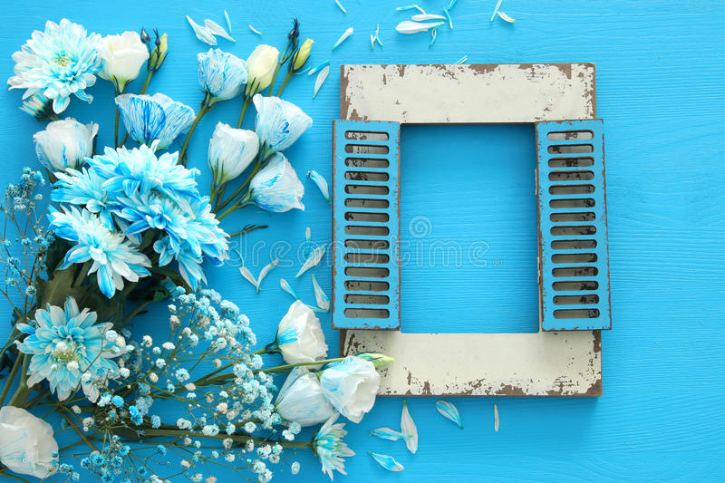 Download Tobeautiful Blue Flowers And Blank Vintage Photo Frame On Wooden Background Stock Image - Image: 93262177
