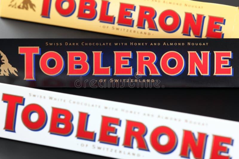 Toblerone chocolate bars. Tambov, Russian Federation - September 23, 2012 100g Toblerone chocolate bars. Swiss white, dark and milk chocolates with honey and stock images