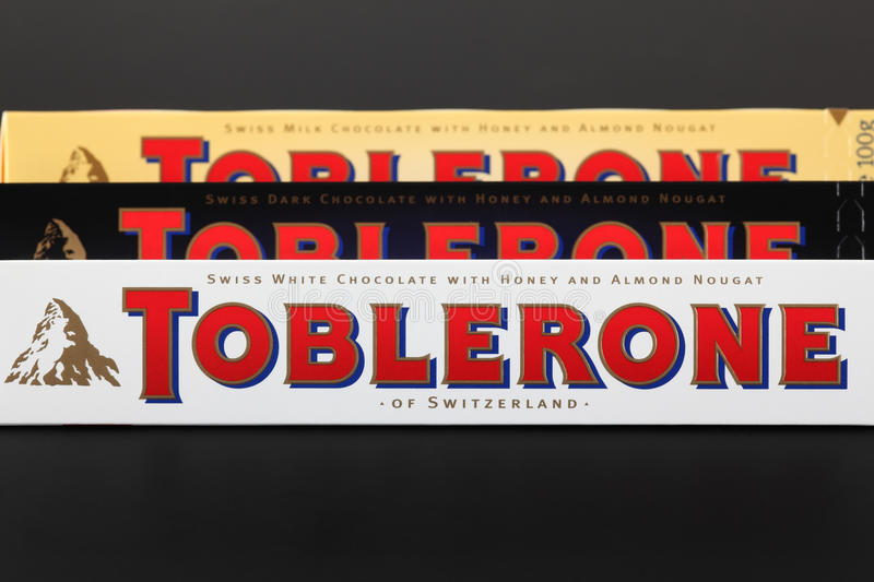 Toblerone chocolate bars. Tambov, Russian Federation - September 23, 2012 100g Toblerone chocolate bars. Swiss white, dark and milk chocolates with honey and royalty free stock images