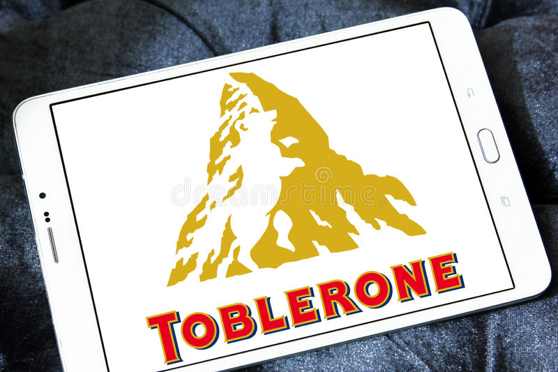 Toblerone chocolate logo. Logo of chocolate brand toblerone on samsung tablet royalty free stock photos