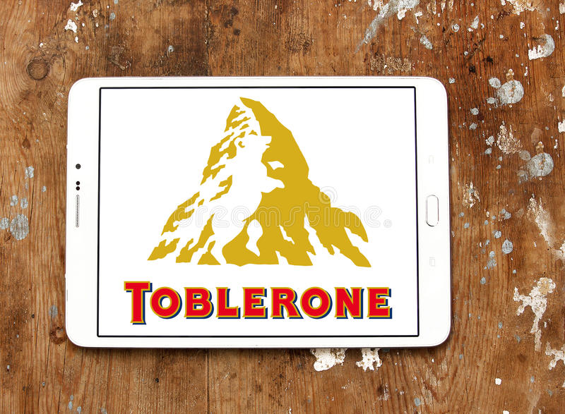 Toblerone chocolate logo. Logo of chocolate brand toblerone on samsung tablet on wooden background royalty free stock photography
