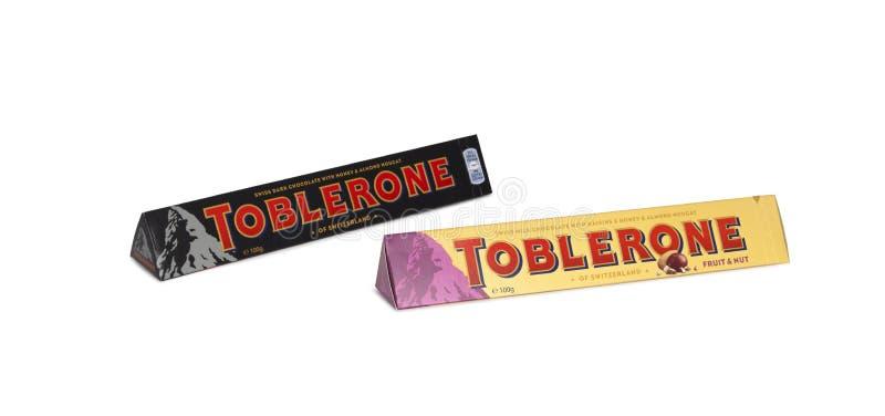 Toblerone - Swiss milk chocolate with honey and almond nougat on. CHISINAU, MOLDOVA - December 8, 2017: A bar of Toblerone - Swiss milk chocolate with honey and stock image