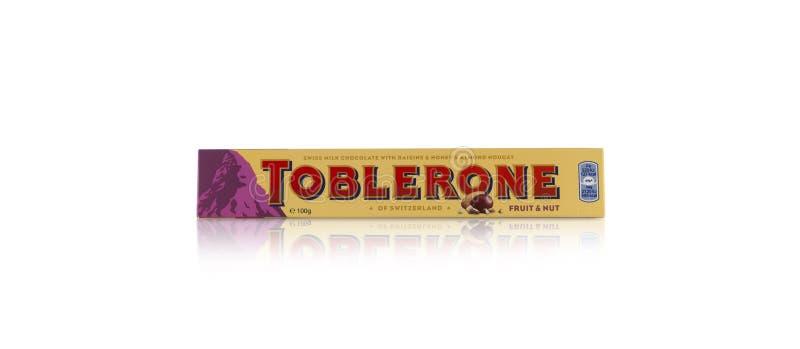 Toblerone - Swiss milk chocolate with honey and almond nougat on. CHISINAU, MOLDOVA - December 9, 2017: Toblerone - Swiss milk chocolate with honey and almond royalty free stock photography