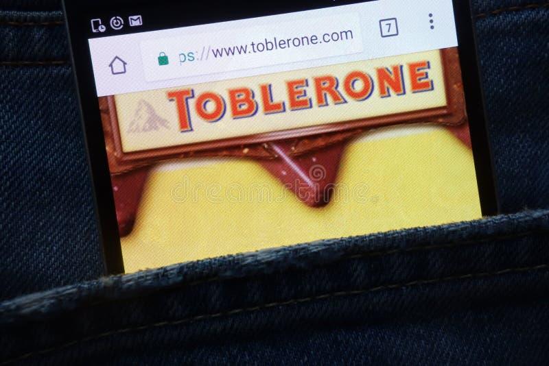 Toblerone website displayed on smartphone hidden in jeans pocket. KONSKIE, POLAND - MAY 18, 2018: Toblerone website displayed on smartphone hidden in jeans royalty free stock photo