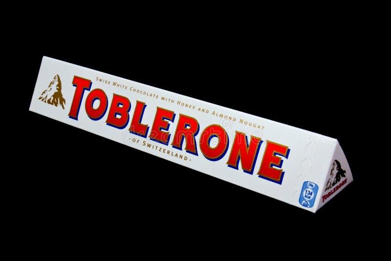 Toblerone white. ZAGREB , CROATIA - JANUARY 15 ,2014 : white swiss Toblerone chocolate on black background , product shot stock image