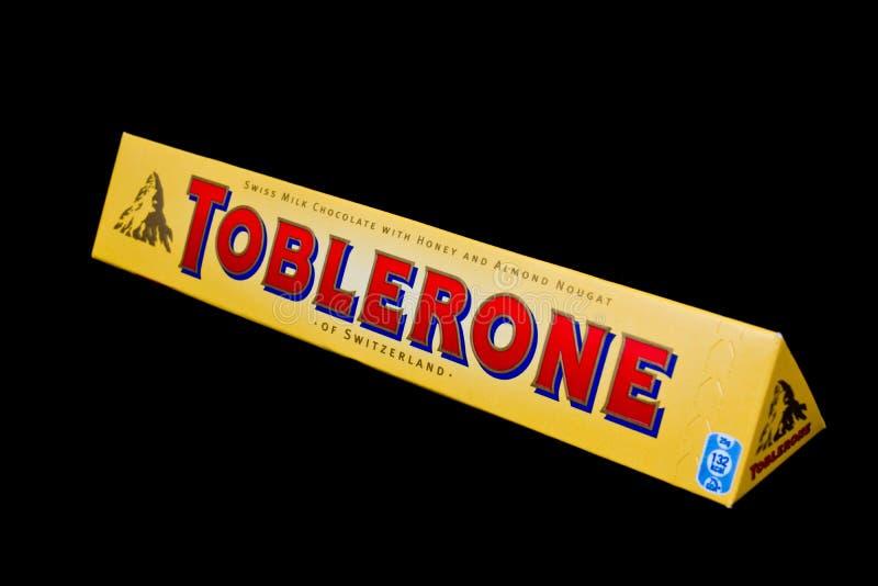 Toblerone. ZAGREB , CROATIA - JANUARY 15 ,2014 : classic swiss Toblerone chocolate on black background , product shot stock images