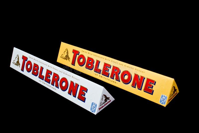 Toblerone. ZAGREB , CROATIA - JANUARY 15 ,2014 : White and classic Toblerone chocolate on black background , product shot royalty free stock photos