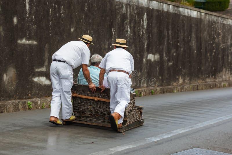 Toboggan ruiters op slee in Monte - Funchal Madera Portugal royalty-vrije stock foto