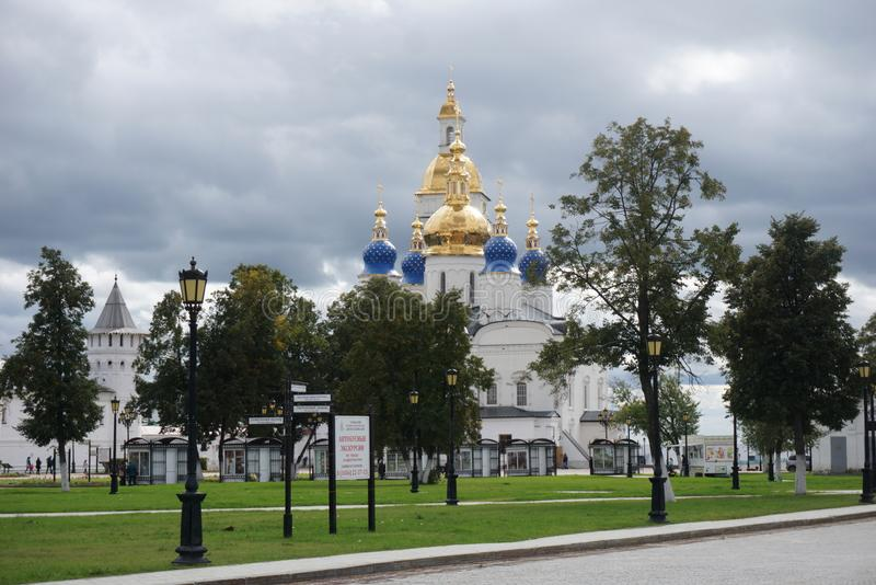 Tobolsk, Russia, 11.09.2016. Christian Church on the background of green trees and blue sky with clouds. The concept of religion stock photo