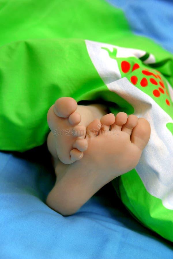 Toca con la punta del pie dormido imagen de archivo libre de regalías
