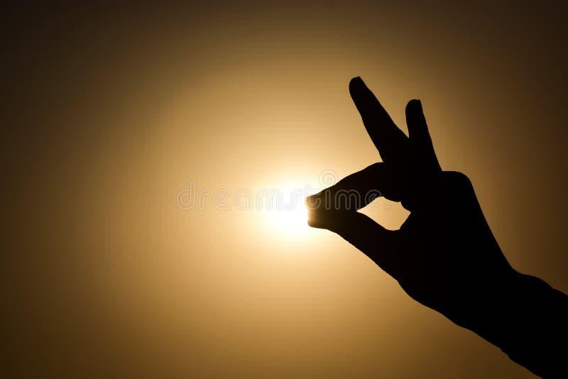 Tocchi il sole immagine stock