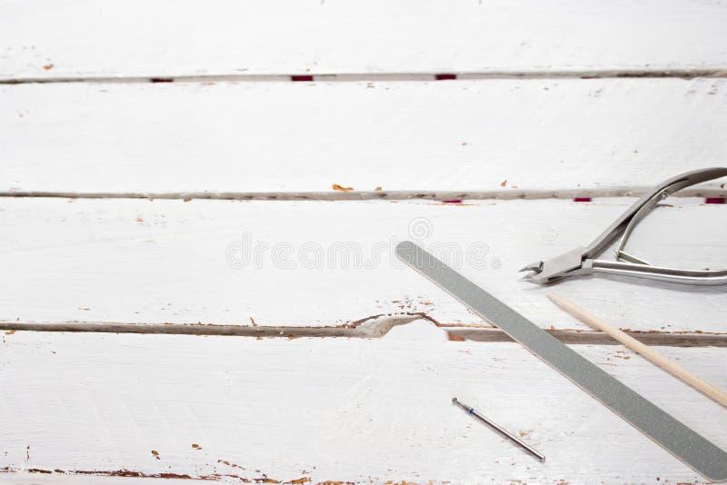 Todavía vida con el equipo de la manicura, herramienta para la manicura, cuidado del clavo imagen de archivo