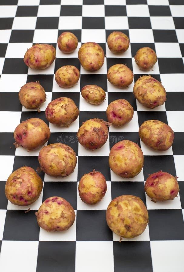 Todavía vida con las patatas fotografía de archivo