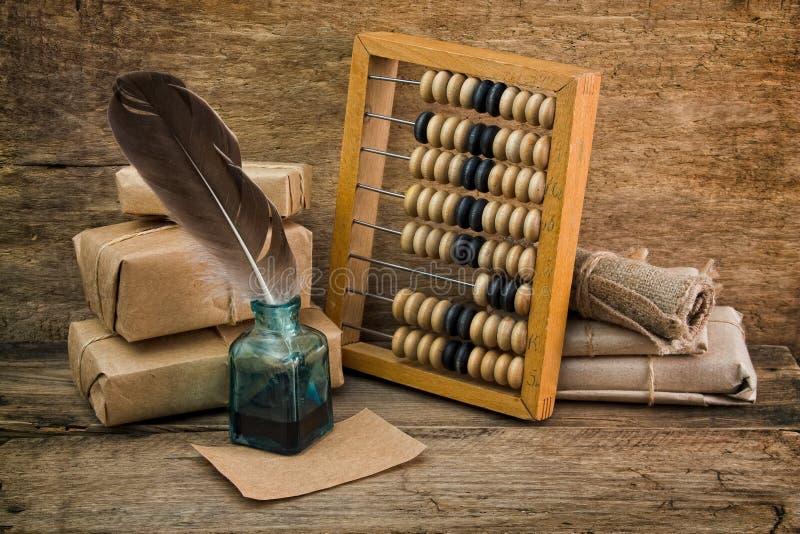 Todavía vida en un almacén con el ábaco imágenes de archivo libres de regalías