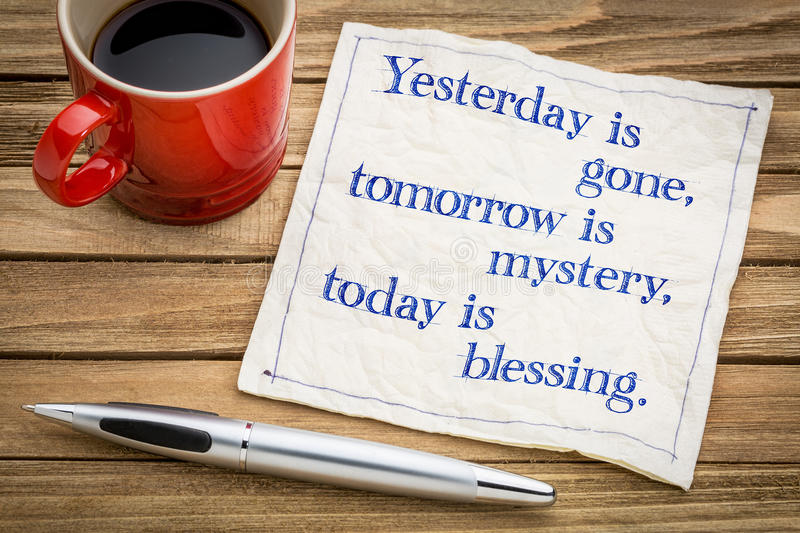 Today is blessing. Yesterday is gone, tomorrow is mystery, today is blessing - handwriting on a napkin with a cup of espresso coffee royalty free stock photo