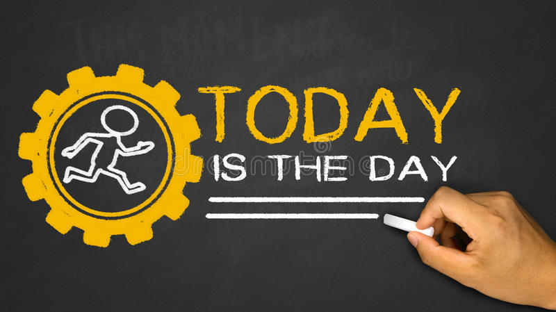 Today is the day. Small person running in gear wheel on blackboard background royalty free stock photo