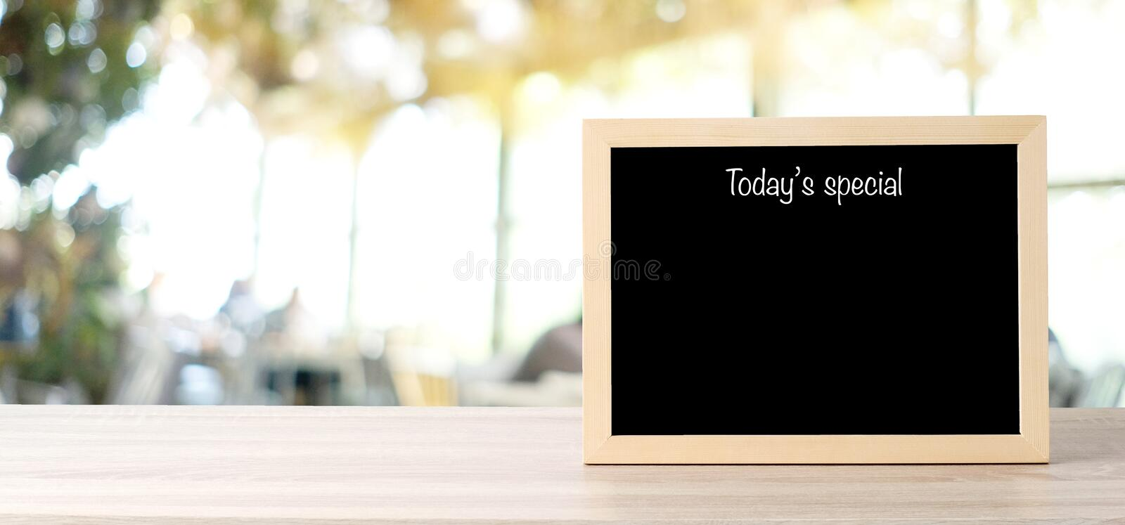 Today's special menu blackboard, sign board, on table at  blur coffee shop, restaurant, with people background, Blank chalkboard stock images