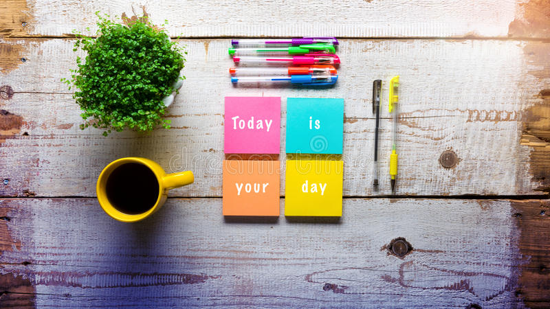 Today is your day, Retro desk with handwritten note. On sticky notes royalty free stock photography