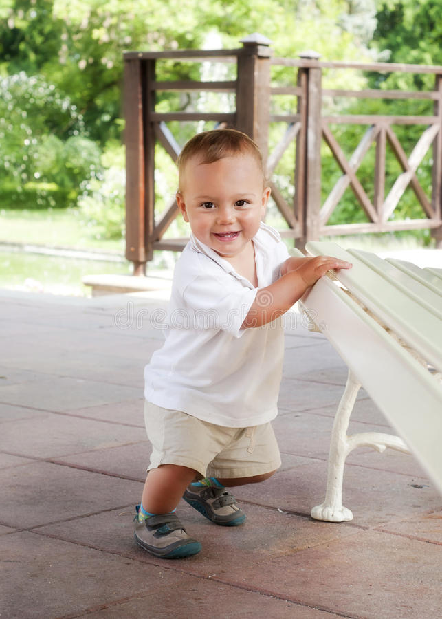 Child learning to walk stock photography