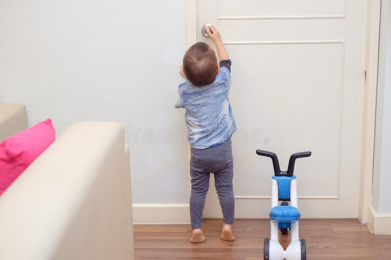 toddler baby boy standing on tiptoes at home stock photography