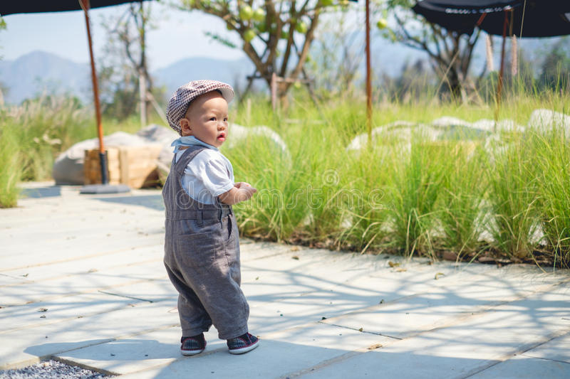 Toddler baby boy walking, baby`s first steps concept royalty free stock photo