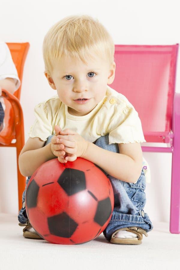 Toddler with a ball stock photos
