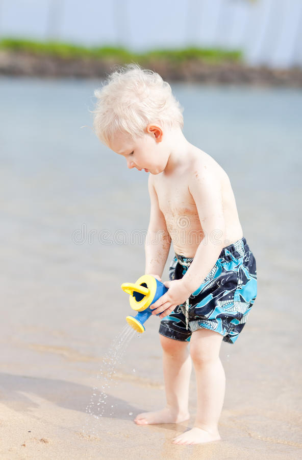 Toddler on a beach stock images